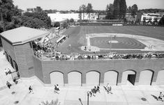 Park Dimensions; The park is symmetrical, measuring 330 feet down the foul lines, 365 to the power alleys and 400 to center. The fence is 14 feet high from left field to left-center, then eight feet high from left-center to right field.  The stadium was designed to complement the architecture of the surrounding campus, and to evoke the aura of baseball's historic parks.