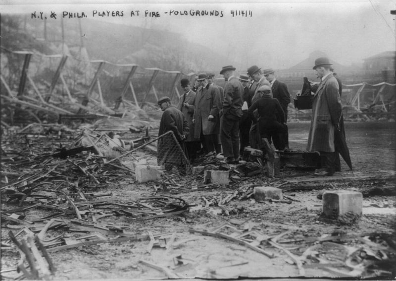 Polo Grounds Fire, April 14, 1911, Giant Players Inspect burned out ruins.